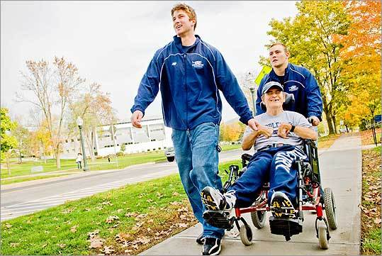 When Butch Varno goes to a Middlebury College game, or just needs to get around, he can always catch a lift from students – in this case, football players Jeff Clarke (left) and Brian Barron.