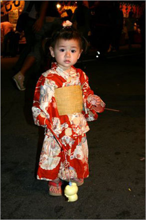 In Ise, a young visitor at Miya River Festival. Festivals bring out many traditionally clad spectators.