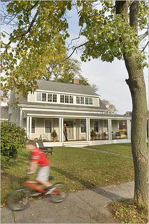 Michael Doherty and Nancy Hackett did more than update their 1856 Cape to suit their vision of 21st-century family life: They celebrated the Beverly house's style, history, and livability. Doherty stood on the home's new wraparound porch as the couple's son, Graham, 11, zoomed by on his bike.