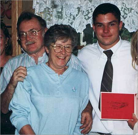 Jarred Aranda (right) stood with his grandfather, Jack Roche (left), and grandmother, Carolyn Roche.
