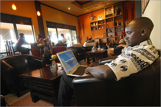 Joseph Katozo, a finance consultant, stays connected at the Bourbon Cafe in the Union Trade Center in Kigali, Rwanda.