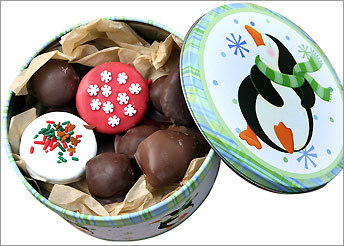 A gift tin of Kriston Welch's Christmas candies and cookies