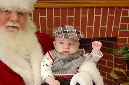 Six month old Jake seems a little surprised to see Santa.