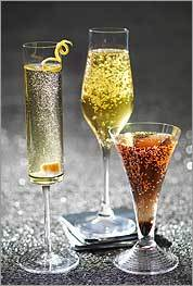 Hosts can make a variety of celebratory drinks with sparkling wine. From left: Classic Champagne Cocktail, Maimoun, and Kir Royale.