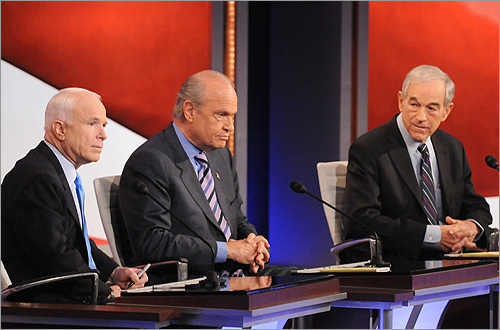 Huckabee wasn't the only one who put Romney on the defensive. John McCain (far left), who is running neck-and-neck with Romney in New Hampshire polls, criticized the former Massachusetts governor's change in positions and television advertisements. At one point when Romney complained he had been misquoted in a news article, McCain quipped: 'You change your positions often enough and you will get misquoted.'