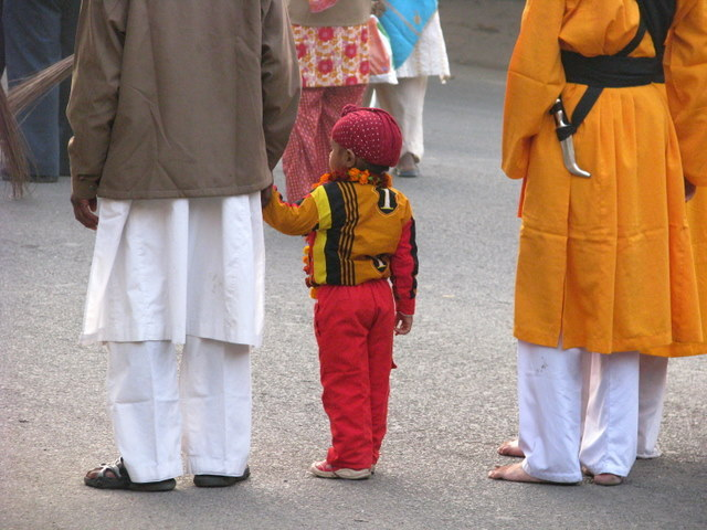A very proud Sikh boy joins the procession.