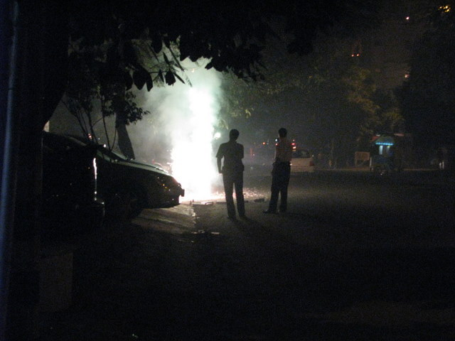 At night, Diwali celebrations can be seen on the street.