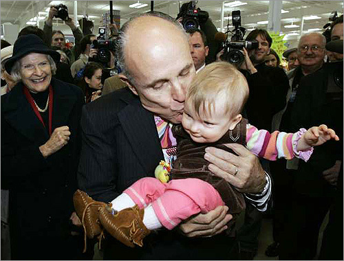 Presidential candidates use a variety of tools to create a positive image -- in-person events, TV ads, mailers, and photo ops, to name a few. And nothing says 'family values' than the age-old tactic of politicians posing with kids. Republican presidential hopeful Mayor Rudy Giuliani (left) kissed a child in this undated photo.