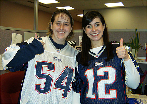 Michelle (left) and Lisa get ready for game day at work in Westborough.