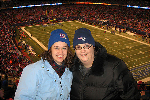 Sisters Janet O'Donnell, of Arlington, Mass., and Nancy O'Donnell Smith cheered on opposite sides at the final game of the regular season at Giants Stadium.