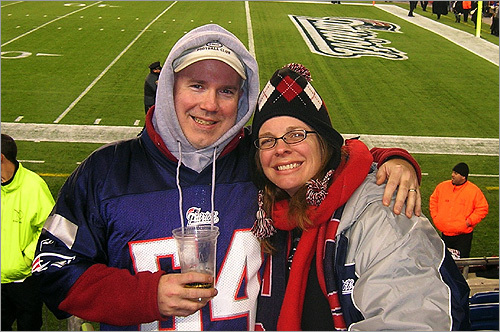 Bill and Becky Blunden of Madison, Miss., say it's hard to be a Pats fan in Manning country. Here, they enjoy a game on home turf at Gillette Stadium.