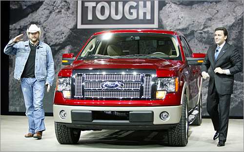 Ford F-150 We're guessing Ford executive vice president Mark Fields (right) won't feature on Toby Keith's next album after this country-corporate duo kicked the tires of the new F-150 pickup. This introduction wasn't as down and dirty as a herd of longhorns corralling around the Ram pickup (yes, that was Dodge responsible for that first photo), but selling pickups is largely a good ol' boy game. We won't delve into details, since it never matters what new features the F-150 has, even if there was an in-dash steak grill. This baby doesn't need Toby, it sells itself. (Reuters Photo / Mike Cassese)
