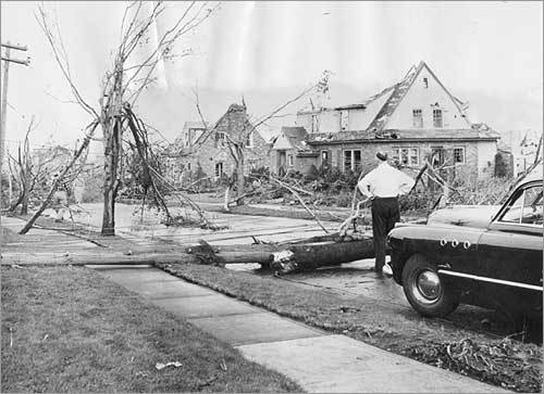 ... and this photo records the aftermath on the same street. Other tornadoes have struck the Berkshires and Connecticut, but none with the magnitude of the 1953 twister in Central Massachusetts.
