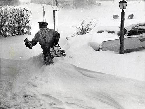 Wild, stormy weather often produces unusual feature pictures, like this image of a milkman wading through snow as he made his rounds in Worcester during a February 1961 blizzard.