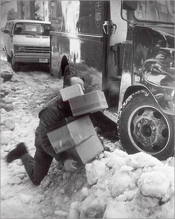 Oops. A UPS man and his packages went down as he tried to make his way across snow and ice in Boston following a 'super storm' that struck New England with hurricane winds and blinding snow on March 13, 1993.