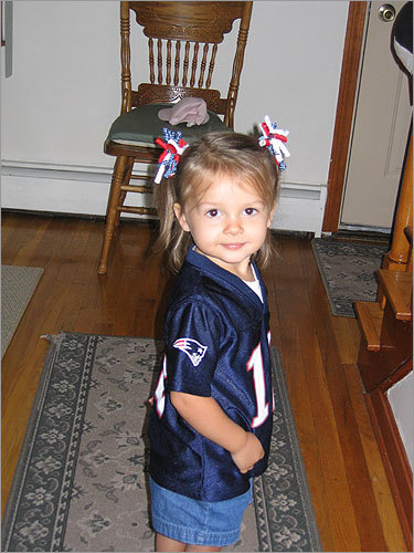Emily, 2, of Lynn, took time to stop for a photo between quarters of the AFC Championship Game.