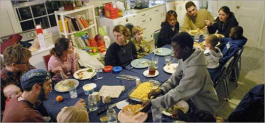 Members of the Rutba House in Durham, N.C., gather for meals and morning and evening prayer.