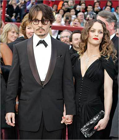Johnny Depp, nominated for an Oscar for best actor in a leading role for his work in 'Sweeney Todd The Demon Barber of Fleet Street,' arrives with his girlfriend Vanessa Paradis.