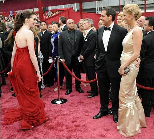 Anne Hathaway, left, greets Steve Carell, center, and his wife, actress Nancy Walls.