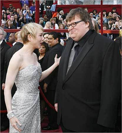 Presenter and Academy Award-winning actress Renee Zellweger greets director Michael Moore, nominated for best documentary feature for his film 'Sicko.'