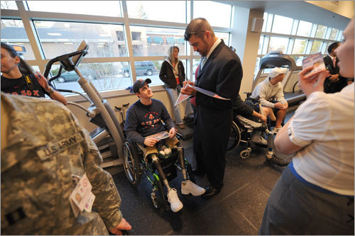 Boston Red Sox catcher Jason Varitek signs an autograph for Sergeant Peter Rooney at the Walter Reed Army Medical Center Wednesday following the Red Sox visit to the White House.