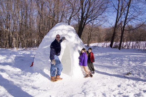 The completed igloo, alongside Brian's daughter Michelle, 8 and son Kevin, 6. Read the story Send us your igloo photos
