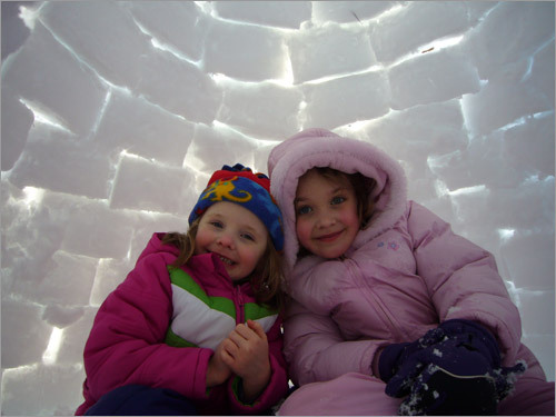 Megan and Anna inside the igloo they helped their dad make. Read the story Send us your igloo photos