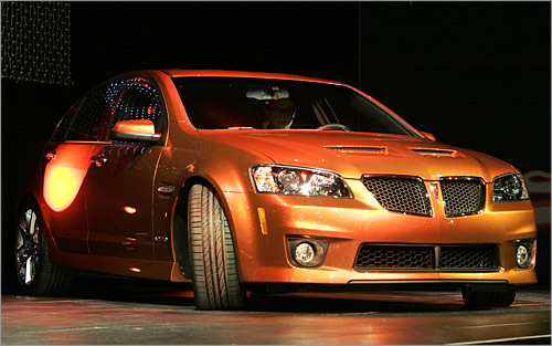 Pontiac G8 GXP So 6.0 liters wasn't enough for you, eh? The GXP bumps the fun up to 6.2 liters and 402 horsepower. Nineteen-inch wheels come standard, as well as the right to brag like a Corvette driver with sub-5 second blasts to 60. Prices will likely hover around $35,000 for this Pontiac range-topper. Finally, an American performance car to match the Cadillac CTS-V, all the better to stare down those Bavarians. (Stan Honda/AFP/Getty Images)