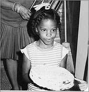 The author, age 6, in her parents' kitchen in suburban Philadelphia. Below, Barack Obama delivers his speech on race in America.