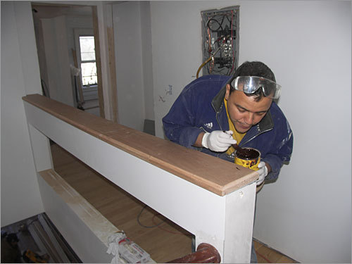 A worker on the home's back staircase.