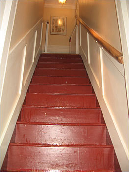 The staircase in the back hall is shown here.