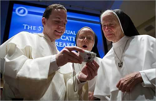 Outside of New York City, the pope's first US visit continued to spark interest. At left, Brother Thomas Petri showed pictures of Pope Benedict XVI to Sister Joseph Andrew and Mother M. Assumpta Long. All three were attending the National Catholic Prayer Breakfast at the Washington Hilton Hotel in Washington, D.C.