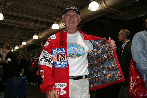Newt Tolman, 66, of Surry, N.H., who estimates he's run nearly 30 marathons, modeled a jacket made by his sister featuring many of his former bib numbers. Featured on the jacket are marathon bibs from Boston, Duluth, Philadelphia, and Maine, among others. He said his favorite is Boston.
