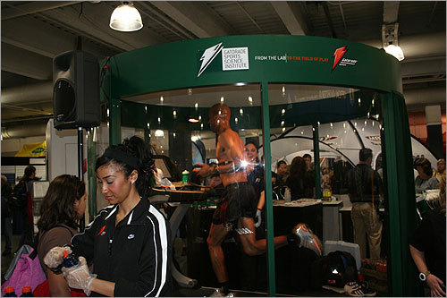 At the Gatorade display at the running expo, a runner ran six-minute miles while doing a 'sweat test' in a display case. Gatorade officials assured the crowd that he would not be running in Monday's race.
