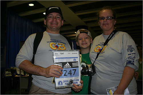 Brian, Jacob, and Nanette Engle traveled from Detroit for dad Brian's first Boston Marathon. Brian, 40, has run five other marathons, including the 'Goofy' at Disneyworld in Florida, which is a half and full marathon run over two days.