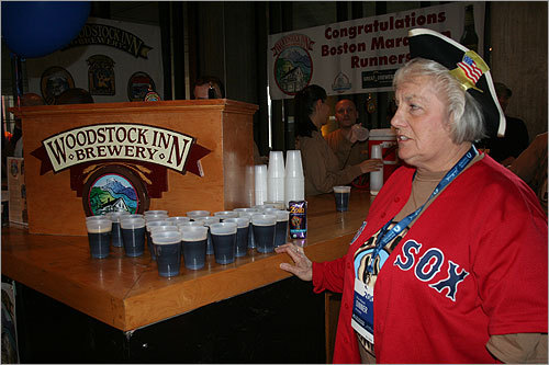 Hawking beer from the Woodstock Inn Brewery, Carol Hunt, 72, of Milton, said she has been volunteering at the marathon for 14 years. 'I just think it's a nice thing to do,' said Hunt, who volunteers with a group of 13 or 14 people with whom she used to work with at NYNEX.