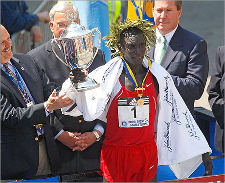 Cheruiyot held his trophy as he was crowned the winner of the men's division.