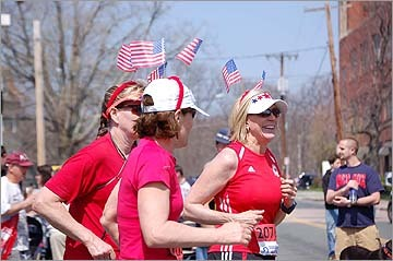 Maina Tran also snapped these patriotic runners as they passed the Ashland clock tower on their way into Boston.