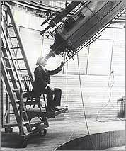 Percival Lowell peers at Mars through his Clark telescope.