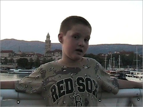Winsor, a young New Yorker, sported his Red Sox gear while on a ferry in the harbor of Split, Croatia.