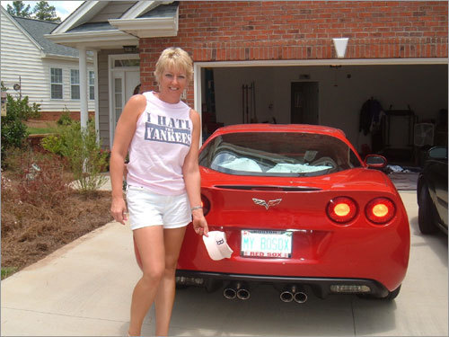 Formerly from Rhode Island but now residing in North Carolina, Susan Ann Lake is a triple threat Red Sox fan, with a Sox-related license plate, shirt, and baseball visor.