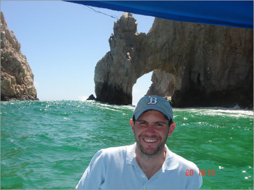 Monroy next to the El Arco de Cabo San Lucas, a distinctive rock formation in Cabo San Lucas.
