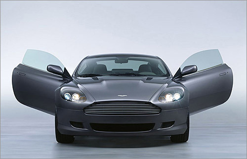 Aston Martin DB9 Least efficient Minicompact EPA City/Highway: 10/16 The DB9 is one of the most beautiful cars ever penned by designer Ian Callum, who was also responsible for the DB7. Its simple grace lies in classic Aston cues, such as the flat-bottom grill, and inspiration from this century, like the doors that scissor upwards. Performance is nothing short of extraordinary. (Aston Martin Lagonda Ltd.)