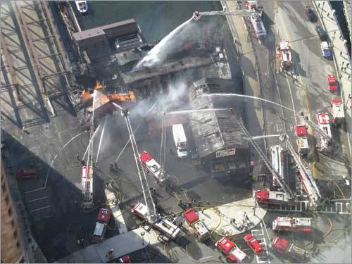 A Boston.com user took these photos from the top of International Place firefighters tackling the blaze.