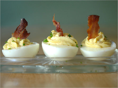 Deviled eggs from a Bedford farm are topped with bits of house-made bacon.
