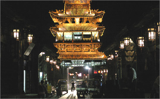 Pingyao's market tower looms large over Mingqing Street.