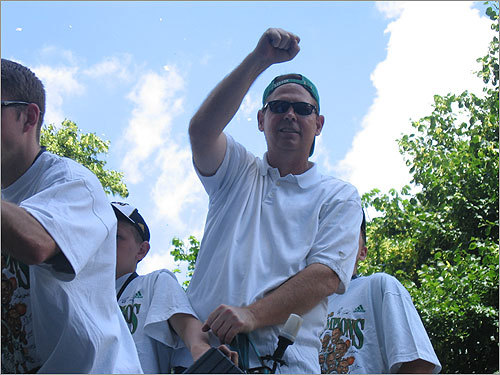 Celtics General Manager (and former player) Danny Ainge gestured to the crowd of parade watchers.