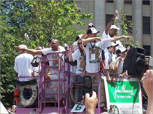 Celtics players and coach Doc Rivers (left) pointed to the crowd.