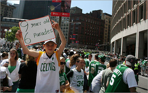 A parade watcher's sign explained just how lucky he was to be a young sports fan in Boston.