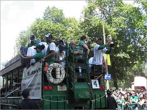 Celtics' captain Paul Pierce held the Most Valuable Player trophy at the back of one of the parade's duck boats.